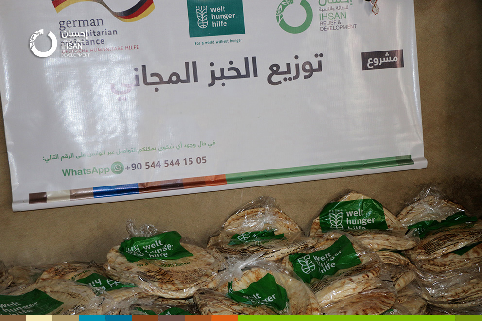 Distributing free bread on the internally displaced people in southern rural of Idlib